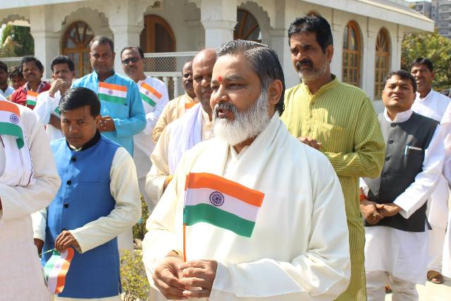 National Flag of India was hoisted at Gurudev Brahmanand Saraswati Ashram, Chhan Bhopal by Brahmachari Girish Ji with Acharyas, Vedic Pundits and staff of Maharishi Ved Vigyan Vidyapeeth. After National Anthem, Rashtra Sukta was also chanted by Yajurvedi Pundits. Addressing the audience Brahmachari Girish Ji said that India is the supreme power in the world having ancient Vedic knowledge and Vedic practical technologies. We need to continue researches to present the knowledge scientifically to the world and to revive the knowledge and techniques. India could offer peace, prosperity, perfect health and invincibility to our dear world family easily. All Vedic scholars have to work together with the sankalpa of creating Heaven on Earth and not deviate with external material attractions.