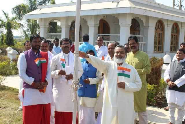 National Flag of India was hoisted at Gurudev Brahmanand Saraswati Ashram, Chhan Bhopal by Brahmachari Girish Ji with Acharyas, Vedic Pundits and staff of Maharishi Ved Vigyan Vidyapeeth. After National Anthem, Rashtra Sukta was also chanted by Yajurvedi Pundits. Addressing the audience Brahmachari Girish Ji said that India is the supreme power in the world having ancient Vedic knowledge and Vedic practical technologies. We need to continue researches to present the knowledge scientifically to the world and to revive the knowledge and techniques. India could offer peace, prosperity, perfect health and invincibility to our dear world family easily. All Vedic scholars have to work together with the sankalapa of creating Heaven on Earth and not deviate with external material attractions.